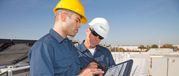 Two Construction Workers Discussing Over Digital Tablet - Structural Fire Protection - Permax